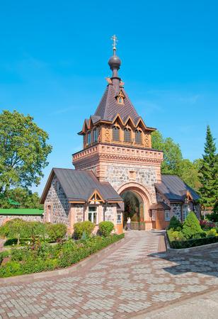 ida: KUREMAE, IDA-VIRUMAA COUNTY, ESTONIA - AUGUST 21, 2016: The Saint Gate with belfry. Puhtitsa Dormition Convent of Russian Orthodox Church