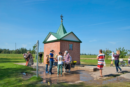 KUREMAE, IDA-VIRUMAA COUNTY, ESTONIA - AUGUST 21, 2016: Pilgrims near The Holy Spring on the place of Marian apparition. Located not far from Puhtitsa Orthodox Dormition Convent