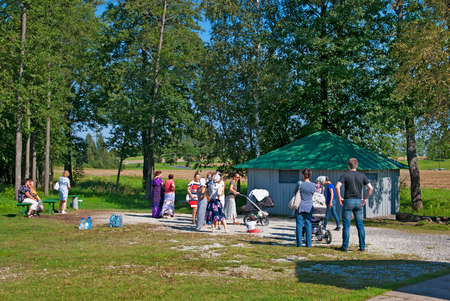 ida: KUREMAE, IDA-VIRUMAA COUNTY, ESTONIA - AUGUST 21, 2016: Pilgrims near baptistery with The Holy Spring water on the place of Marian apparition. Located not far from Puhtitsa Orthodox Dormition Convent Editorial