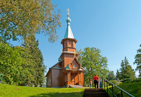 KUREMAE, IDA-VIRUMAA COUNTY, ESTONIA - AUGUST 21, 2016: Church of St Arsinius and St Nicholas on the monastery cemetery. Puhtitsa Dormition Convent. The Estonian Orthodox Church of Moscow Patriarchate Editorial