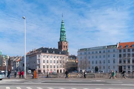 islet: COPENHAGEN, DENMARK - APRIL 13, 2010: People near Slotsholmens Kanal (The Castle Islet Channel). On the background is Nikolaj Art Center (last Saint Nikolaj Church) Editorial