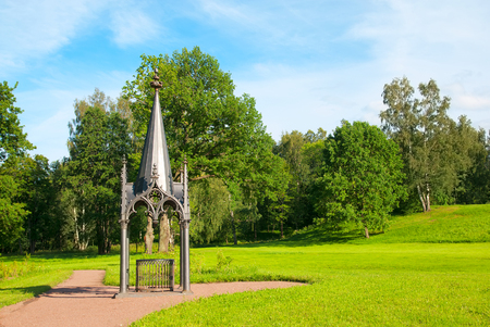 residences: PETERHOF, SAINT - PETERSBURG, RUSSIA - JULY 14, 2016: Gothic well. Alexandria Park. It is the palace and park ensemble and one of the summer residences of the Russian Emperors from 1830 until 1917