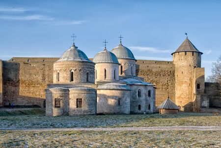 IVANGOROD, RUSSIA - JANUARY 3, 2017: Ancient Church of Saint Nicholas and Church of Dormition of the Mother of God on territory of Ivangorod Fortress that was built in 1492. Now it is a museum. Editorial