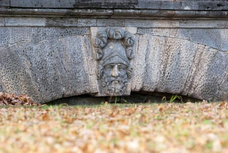 Tsarskoye Selo, Saint-Petersburg, Russia - October 15, 2019: The Ramp with mask of the ancient deity in The Catherine Park near Cameron Gallery. The Tsarskoye Selo is State Museum-Preserve