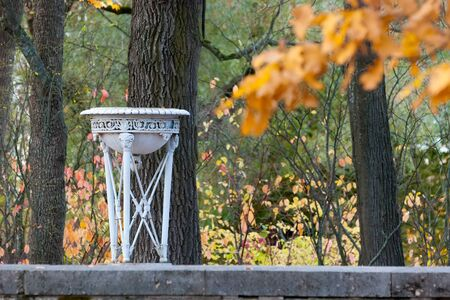 Tsarskoye Selo, Saint-Petersburg, Russia - October 15, 2019: Old vase on The Ramp near The Cameron Gallery in the autumn Catherine Park. The State Museum Preserve Tsarskoye Selo