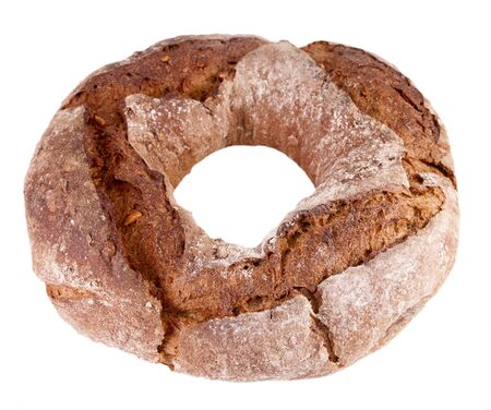 Rye-wheat bread in a ring form with sunflower seeds isolated on a white background Stockfoto