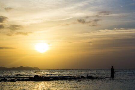 fisher man: Fisher man Fishing when Sunset at Koh Lan Pattaya