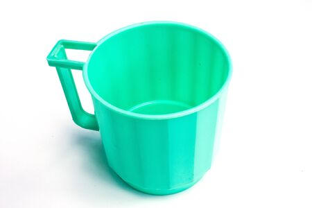 Green cup in white background photo