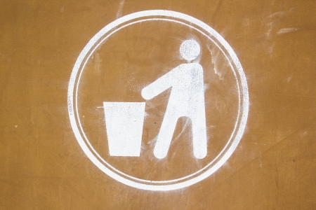 violator: Dirty recycling sign in brown background Stock Photo