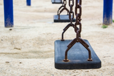 Swing on the playground in garden photo