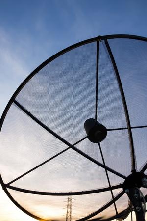 data transmission: Black Satellite dish in evening sky