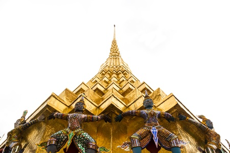 The Golden Pagoda and Yak statue at the phra keaw, bangkok,Thailand photo