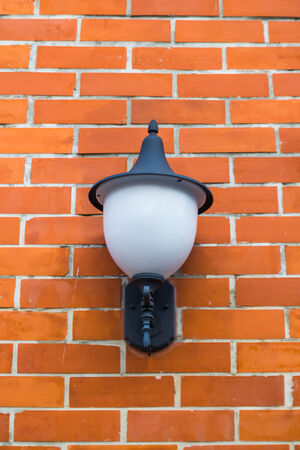 Lamp on a Brick Wall photo