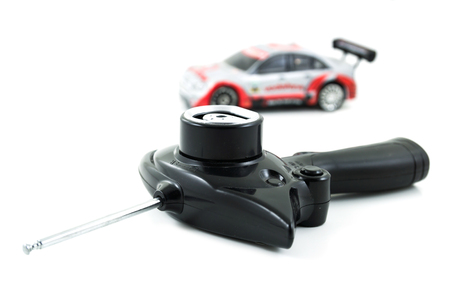 Toy RC Car Controller and Toy Car on White  photo