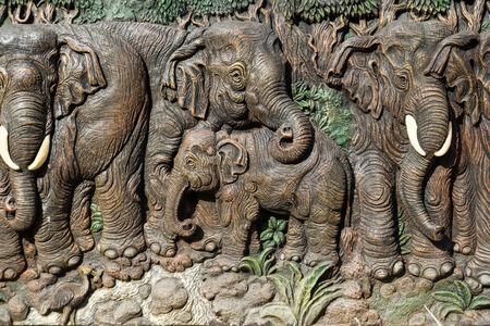 carve: Beautiful elephants carve on wood