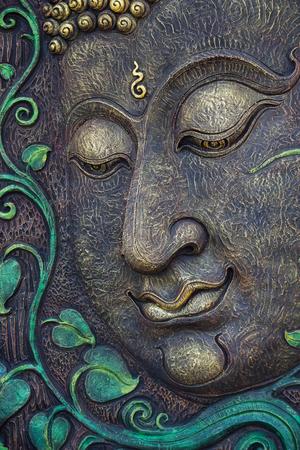 carve: Beautiful buddha face carve background