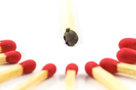 Red match stick around burnt match stick isolated on white  photo