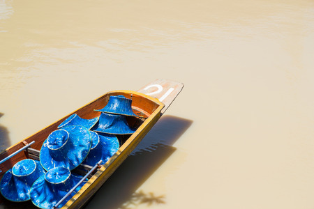 Row boat with hat on the water photo