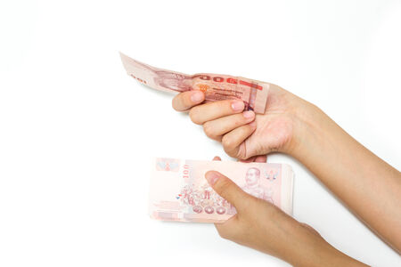 Hand with money on a white  photo