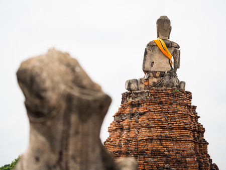 Old Buddha statue at Wat Chai Watthanaram, Ayuttaya,Thailand photo
