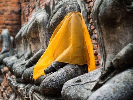 Old Buddha statue at Wat Chai Watthanaram, Ayuttaya,Thailand photo