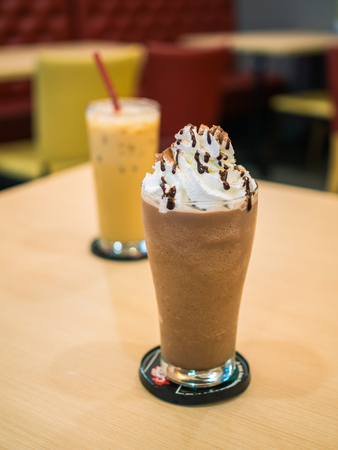 frappe: Delicious chocolate frappe with whipped cream on table