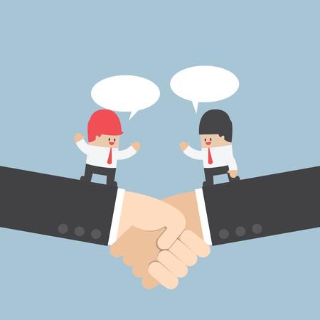 saludo de manos: Hombre de negocios hablando con la asociación en un apretón de manos