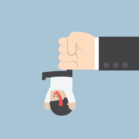 upside down: Businessman hanging from upside down by a big hand VECTOR