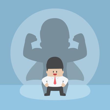 Uomo d'affari con il suo forte ombra, di successo, di leadership, concetto fiducioso