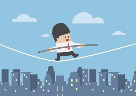 Businessman walking on a rope over the city, business risk concept