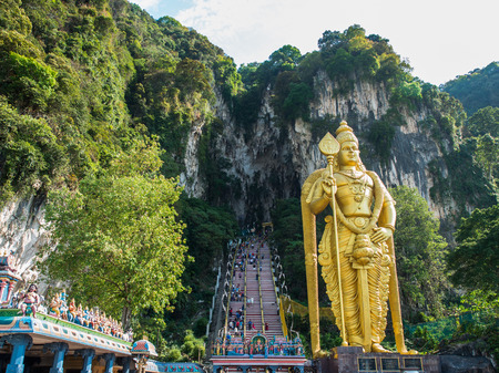 Tourist and Lord Murugan Statue in front the batu cave entrance