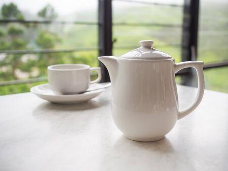 boh: White teapot and tea cup on the table at Boh Tea Plantation, Cameron Highlands, Malaysia