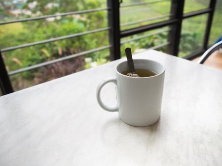 boh: White tea cup on the table at Boh Tea Plantation, Cameron Highlands, Malaysia