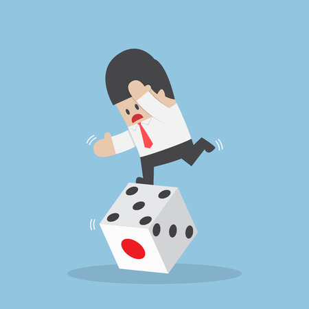 business risk: Businessman standing on unstable dice, business risk and luck concept