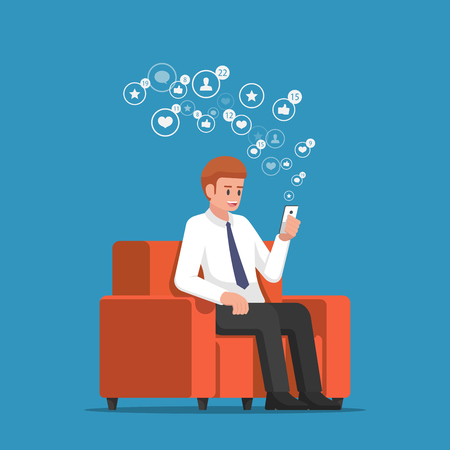 Businessman sitting at sofa and holding smartphone with social network notification icons. Social media marketing and smartphone addiction concept.