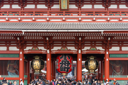 TOKYO, JAPAN - November 19, 2018:  Tourists at The Hozomon Gate or entrance of  Sensoji Temple in Asakusa. Most popular attraction and oldest Temple in Tokyo.