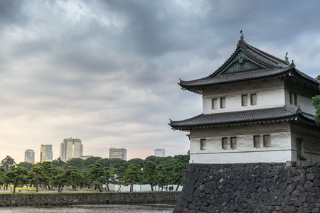 TOKYO, JAPAN - November 20, 2018: The japanese style fort located in the Imperial Palace Tokyo in cloudy day.