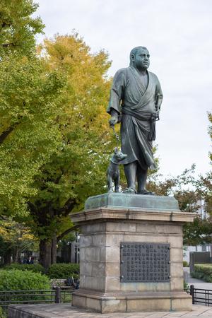 TOKYO, JAPAN - November 18, 2018:  Statue of Saigo Takamoriand and his pet dog at Ueno Park in Tokyo.