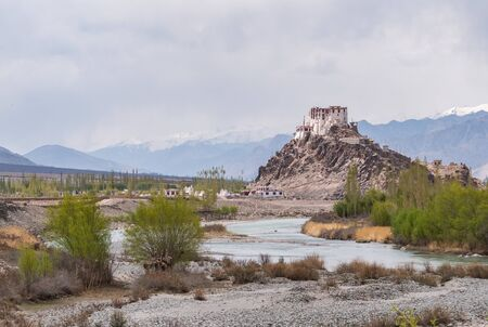 Stakna monastery above Indus river with view of Himalayan mountains located in Leh Ladakh, northern India state of Jammu and Kashmir, India.