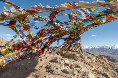 Colorful prayer flags on rock mountain in Leh Ladakh, India. 版權商用圖片
