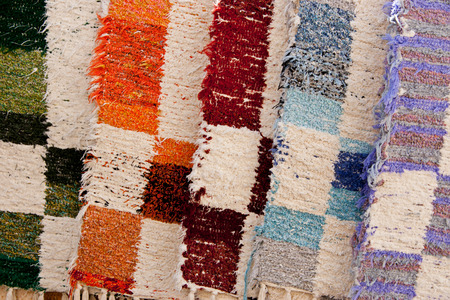 Detail shot of a background texture of some wool carpets hanging in a fabric store