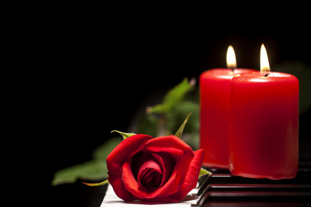 Red Rose and Candle on Piano Keys photo