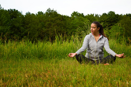 Young Woman Meditation Concept in Nature Stock Photo