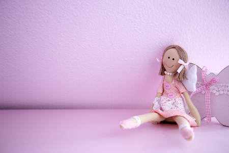 school room: Baby Doll on Pink Wall