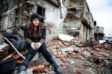 devastation: Wreckage Deconstruction Area and Young Woman Stock Photo