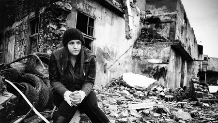 Wreckage Deconstruction Area and Young Woman Stock Photo