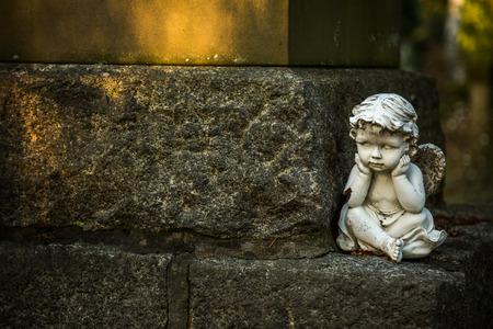 Angel Statue near the Stone Wall 写真素材
