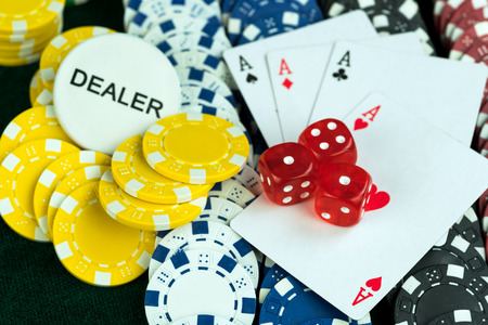 red dice: Gambling Red Dice Poker Cards and Money Chips Stock Photo