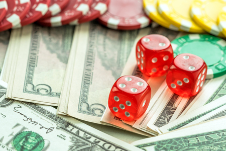 red dice: Gambling Red Dice American Dollars and Money Chips Stock Photo