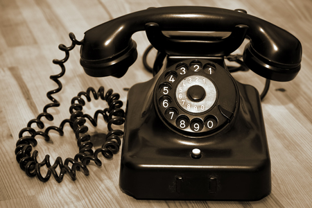 phone cord: Vintage Old Classic Telephone Communication Device Stock Photo